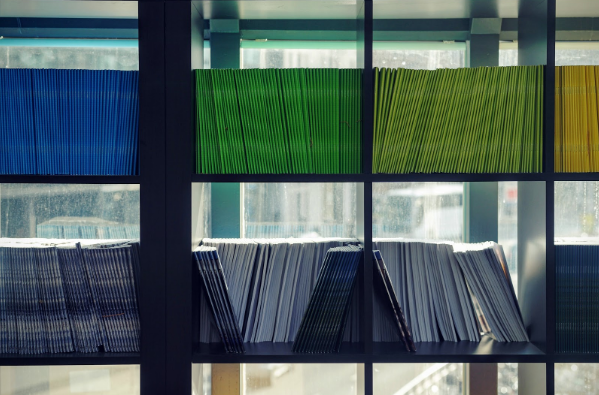 A collection of documents organized on a shelf.